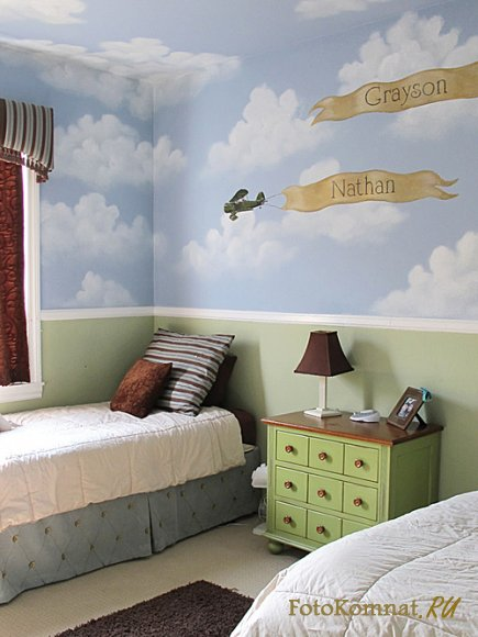 Kids room with blue sky and white clouds painted on wall and ceiling, double twin beds, green side table with small drawers.